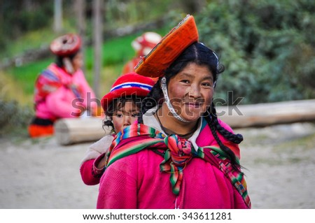 THE ANDES, PERU - MAY 30, 2012: Quechua mother and daughter in a village in the mountains of The Andes over Ollantaytambo, Peru - stock photo