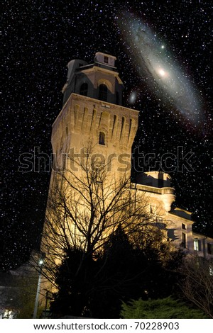The Andromeda galaxy over the ancient tower of Padua astronomical observatory, Italy. - stock photo