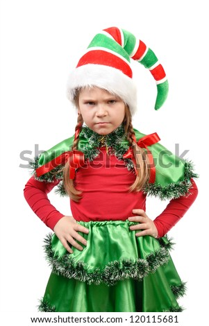 The angry little girl - Santa's elf  on a white background - stock photo
