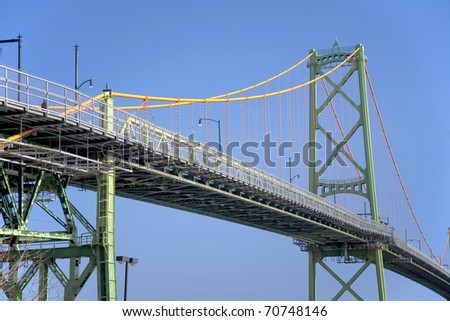 The Angus L Macdonald suspension bridge over Halifax Harbour linking Dartmouth and the city of Halifax in Nova Scotia, Canada. - stock photo