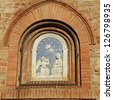 The Annunciation in glazed terracotta on wall in Certaldo, Tuscany, Italy, Europe - stock photo