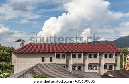 The apartment house and the sky . - stock photo
