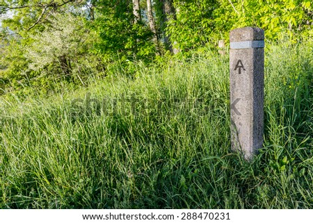 The Appalachian Trail is blazed with these stone markers at every crossing with Skyline Drive through Shenandoah National Park - stock photo