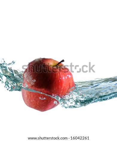 The apple falls in water - stock photo