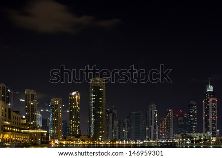 The Arabian city of Dubai at night - stock photo