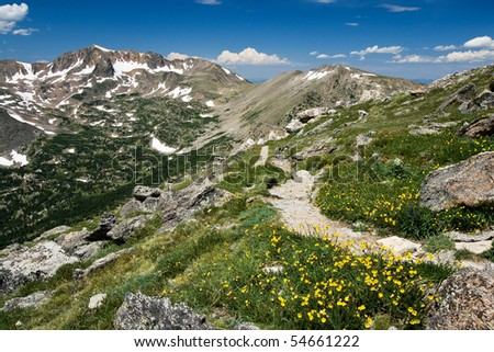 The Arapaho Trail climbs through the Colorado Rocky Mountains as it passes over the Continental Divide - stock photo