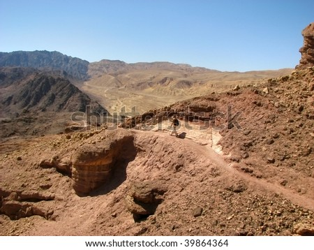 The Arava desert, different colored sand and stones. Eilat mountains.Israel.