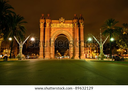 The Arc de Triomf, archway structure in Barcelona, Spain, at night. It was built for the Exposición Universal de Barcelona (1888). - stock photo