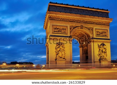 The Arc de Triomphe at night in Paris, France. - stock photo