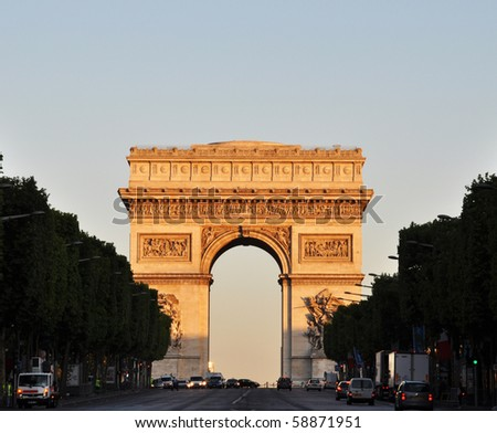 The Arc de Triomphe at sunrise - stock photo