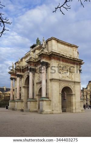 The Arc de Triomphe du Carrousel. It is a triumphal arch in Paris, located in the Place du Carrousel and is derivative of the triumphal arches of the Roman Empire. - stock photo
