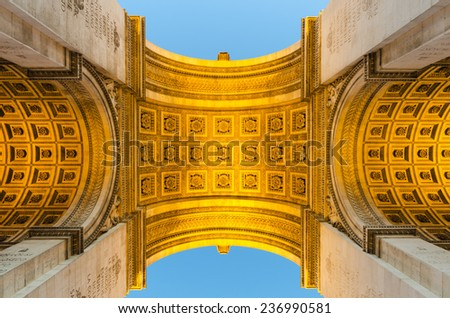 The Arc de Triomphe in Paris, France, photographed from below at night.  - stock photo