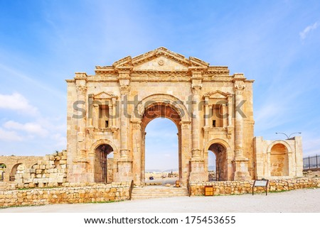 The Arch of Hadrian in Jerash, Jordan is an 11-metre high triple-arched gateway erected to honor the visit of Roman Emperor Hadrian to the city in the winter of 129-130.  - stock photo