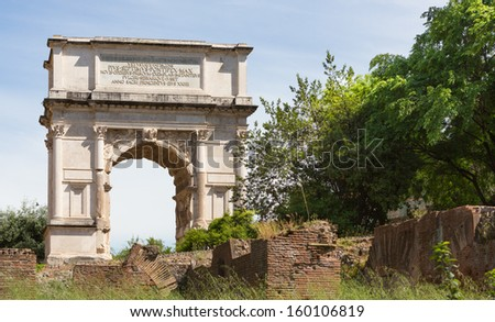 The Arch of Titus at the Forum ruins in Rome, Italy. - stock photo