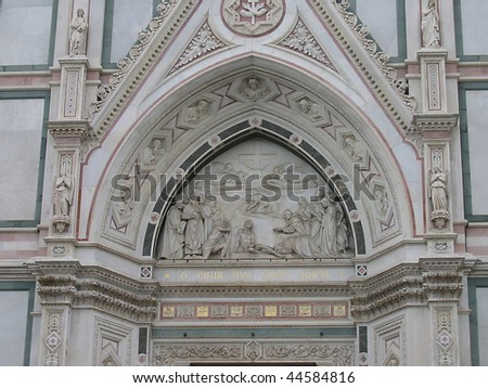 The arch over the entrance to the Cathedral of Santa Croce, Firenze - stock photo