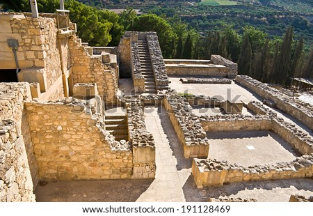 The archaeological site of Cnossos Palace located next to Heraklion and surrounded by agricultural lands with olive-woods, Crete, Greece. - stock photo