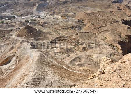 The archaeological site of Masada. View from fortress at the roman military camp F, E and siege ramp built the Legio X Fretensis during the siege operation in 72 C.E. - stock photo