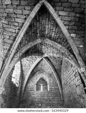 The arched vault of the temple in the ancient city of Caesarea, Israel (black and white) - stock photo