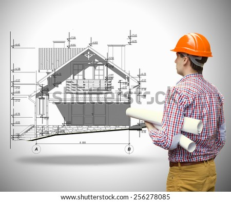 the architect is looking at the house - stock photo
