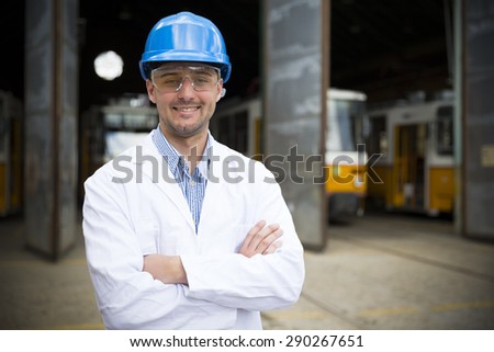 The architect stand next to the tram factory - stock photo