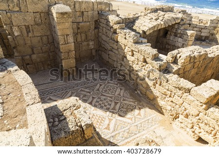 The architecture of the Roman period in the national park Caesarea on the Mediterranean coast of Israel. Preserved fragment of Roman mosaics on the floor - stock photo