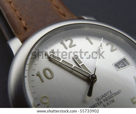 The arm watch with the leather strap