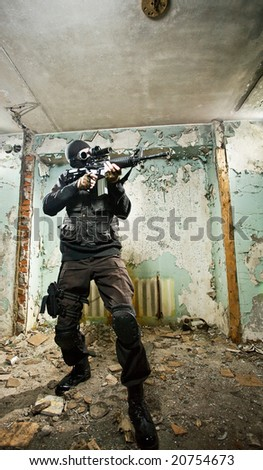 The armed soldier in a camouflage costs in alertness - stock photo
