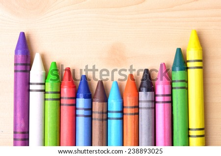 The arrangement of colorful wax crayon - stock photo