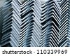 The arrangement of hot-dip steel angle before packing. - stock photo