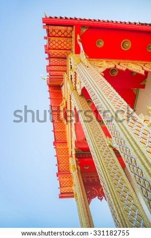 The art design of temple, Bangkok, Thailand. Beautiful gold color and yellow style traditional Thai architecture.  - stock photo