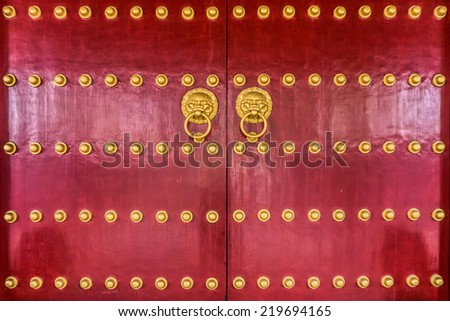 The art of red Chinese temple wooden door - stock photo