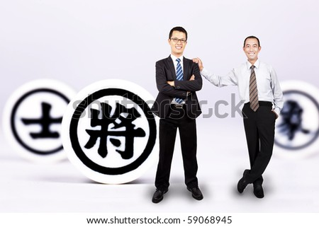 The art of war. two businessman with chinese chess : King,general and prime minister - stock photo