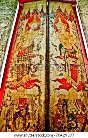 The Art Thai  painting on the wooden door in the temple. This is traditional and generic style in Thailand. No any trademark or restrict matter in this photo. - stock photo