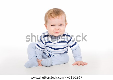 The artful toddler boy sitting on the floor - stock photo
