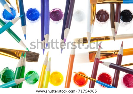 The Artist Tools - Colored Pencils and Paint with various size Brushes. - stock photo