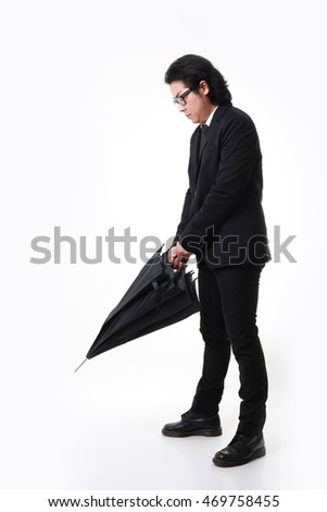 The Asian businessman standing on the white background.