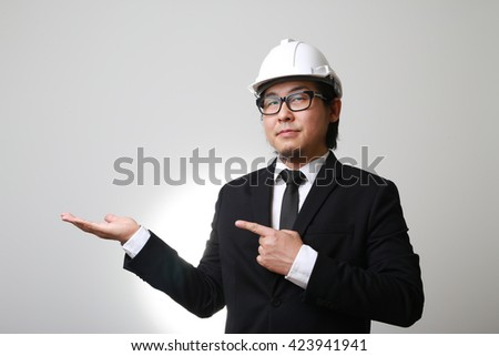 The Asian engineer pointing. - stock photo