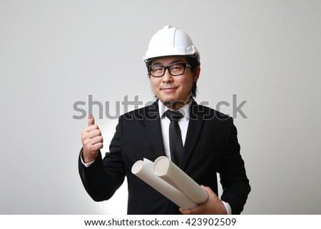 The Asian engineer showing thumb up. - stock photo