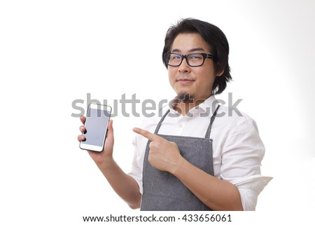 The Asian man with smartphone. - stock photo