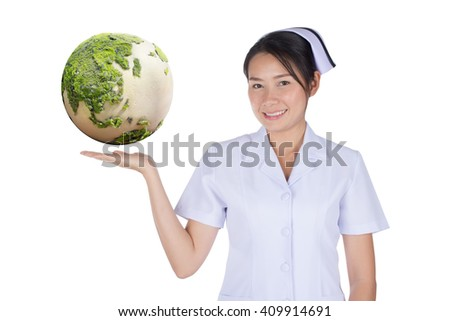 The Asian nurse and earth on hand with clipping path, focused at  the earth and hand