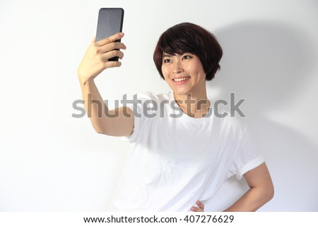 The Asian woman taking photo from smartphone.