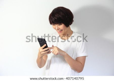 THe Asian woman texting message on smartphone.