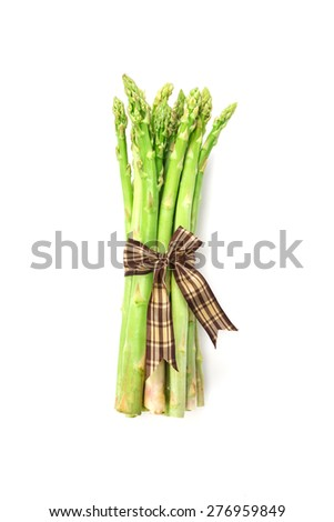 the Asparagus bind with brown ribbon on white background