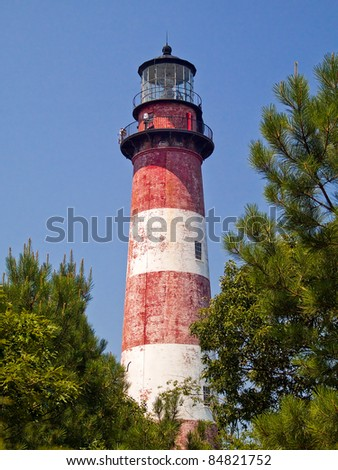 The Assateague Island Light stands on the Virgina portion of Assateague Island. The red and white striped lighthouse was built in 1833 and stands 142 feet tall.