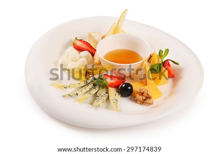 The assorted cheese with honey with strawberries - stock photo