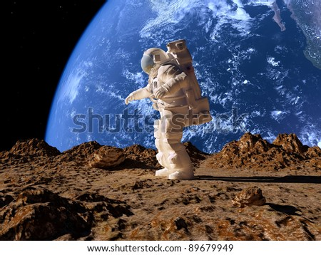 The astronauton a background of a planet - stock photo