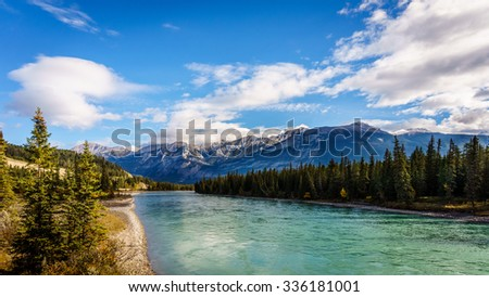 The Athabasca River seen from the Bridge of Maligne lake Road in Jasper national Park in the Canadian Rockies - stock photo