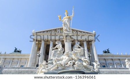 The Athena Fountain (Pallas-Athene-Brunnen) in front of the Parliament. It was created between 1893 and 1902 by Carl Kundmann, Josef Tautenhayn and Hugo Haerdlt, based on plans by Baron von Hansen. - stock photo
