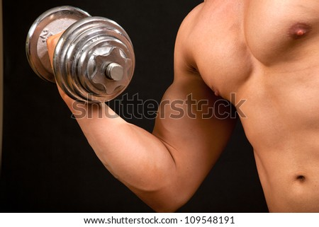 The athlete performs forceful exercise - stock photo