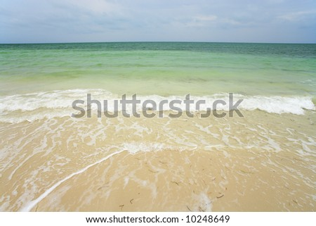 The Atlantic ocean on a beach in the Florida Keys. - stock photo